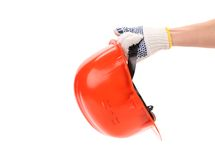 Hand in gloves holds hard hat. Stock Photography
