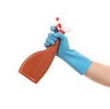 Hand in gloves holds spray bottle. Stock Image