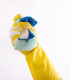 Hand with gloves squeezing sponge Royalty Free Stock Photography