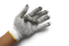 Hand gloves and steel nuts on white background Stock Photo