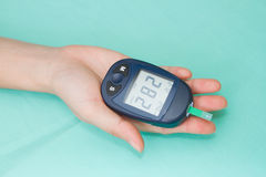 Hand with glucometer Royalty Free Stock Images