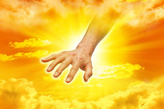 Hand Of God. A hand reaching down from the sky royalty free stock images
