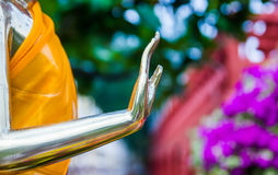 Hand of gold buddha statue Royalty Free Stock Image