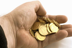 Hand with gold coins. On the white background royalty free stock images