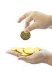 Hand with gold coins Stock Image