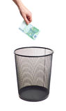 Hand gold euro to trash can Royalty Free Stock Photo