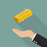 Hand with gold ingot Royalty Free Stock Photos