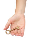 Hand with gold key Royalty Free Stock Photo