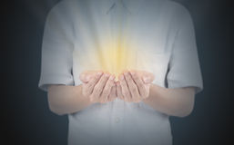 Hand with gold light. Stock Photos