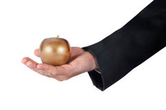 Hand with golden apple Stock Photo