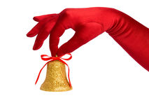 Hand with golden bell Royalty Free Stock Images