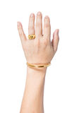 Hand with golden bracelet and ring Stock Photo