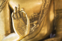 Hand of the golden Buddha 02. Hand of a golden Buddha sculpture stock photography