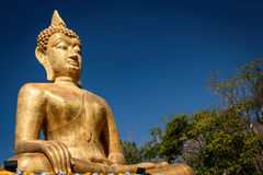 Hand of Golden Buddha statue. In Buddhist  temple or wat, is public domain or treasure of Buddhism. Shot at outdoor ,public area Stock Photos