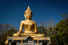 Hand of Golden Buddha statue. In Buddhist  temple or wat, is public domain or treasure of Buddhism. Shot at outdoor ,public area Stock Image