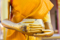 Hand of golden buddha statue holding alms bowl Stock Images