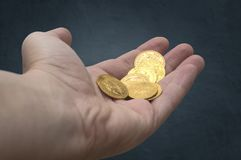 Hand of golden coins. Royalty Free Stock Photography