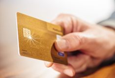 Hand with golden credit card Stock Image