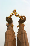 Hand and golden flower. The hands put up the golden flower Stock Photos