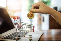 hand with golden metal Bitcoin crypto currency investment- symbolic block chain financial internet and technology. stock image