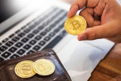 hand with golden metal Bitcoin crypto currency investment- symbolic block chain financial internet and technology. royalty free stock photos