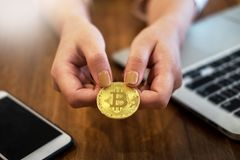hand with golden metal Bitcoin crypto currency investment- symbolic block chain financial internet and technology. royalty free stock photo