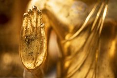 Hand of a golden Monday Buddha statue. At Doi Suthep Temple Chiang Mai - Thailand stock images