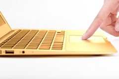 Hand in the golden notebook computer Royalty Free Stock Photo