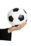 Hand golding soccer ball Royalty Free Stock Images
