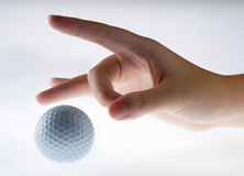 Hand with golf-ball. With toning white to gray background royalty free stock images