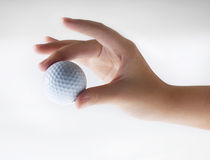 Hand with golf-ball Royalty Free Stock Images