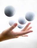 Hand with golf-ball. With toning white to gray background