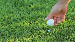 Hand with golf ball stock video footage