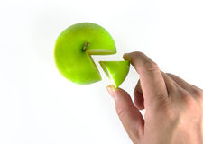 Hand got piece of green apple isolated Stock Photography