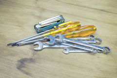 Hand grab, hold Old ,rusty tools lying on a wooden table stock photography