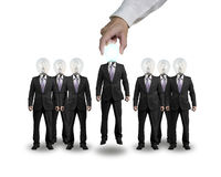 Hand Grab and lift one businessman with lighting bulb head Royalty Free Stock Photo