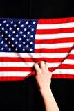 Hand Grabbing American Flag royalty free stock photos