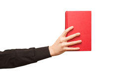 Hand grabbing book Royalty Free Stock Photos