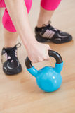 Hand grabbing fitness equipment Stock Photos