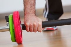Hand grabbing fitness equipment Stock Images