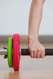 Hand grabbing fitness equipment Royalty Free Stock Photography