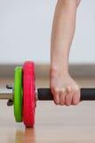 Hand grabbing fitness equipment Royalty Free Stock Photography