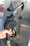 Hand Grabbing Nozzle on a Gas Pump Royalty Free Stock Image