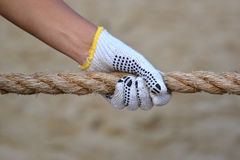 Hand Grabbing On Rope In Tug Of War Stock Image