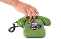 Hand grabs telephone handset Stock Images