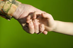 Hand of grandmother and granchild Stock Photography