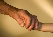 Hand of grandmother and grandchild Stock Photos
