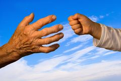 Hand of grandmother and grandchild Royalty Free Stock Image