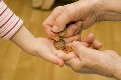 Hand of grandmother and grandchild with the money Royalty Free Stock Images