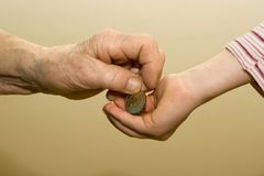 Hand of grandmother and grandchild with the money Stock Images